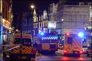 Emergency services attend the scene at the Apollo Theatre in Shaftesbury Avenue today in central London.