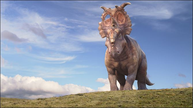 Film Review Walking with Dinosaurs A mature Pachyrhinosaurus named Patchi is shown in a scene from the film,