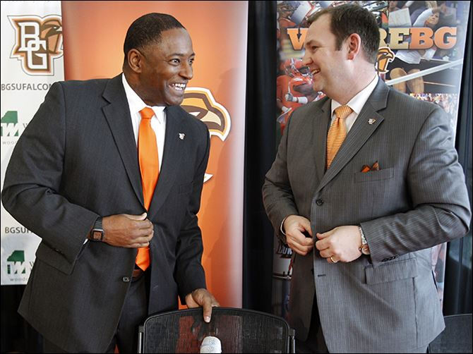 s6dino Dino Babers, left, is introduced by Falcons athletic director Chris Kingston after being named 18th football coach in BG history during a news conference Thursday at the Stroh Center.