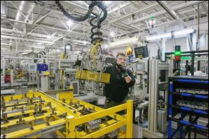 Jeff Roe of Oregon works on a six-speed transmission at GM's Toledo Transmission plant. In 2009, employment at the plant had fallen to fewer than 500, said Ray Wood, president of United Auto Workers Local 14. Now the Alexis Road plant employs 1,890 people. 'Our plant is alive and well because of the bailout,' Mr. Wood said.