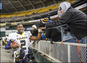 Toledo quarterback Terrance Owens celebrates a 42-41 win against Air Force in the 2011 Military Bowl at RFK Memorial Stadium in Washington. Attendance was 25,042 — capacity is 56,692.