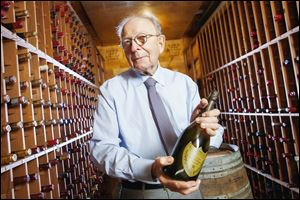 Dr. Ken Bleifer holds a 1990 Dom Perignon inside the wine cellar of his Los Angeles-area home, filled with nearly 1,800 bottles. When he began his collection he didn't think of it as an investment.