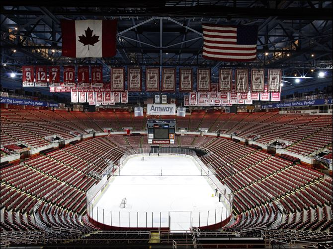 Championship banners and retired numbers of the Detroit Red Wings hockey team hang from the rafters above the ice at Joe Louis Arena in Detroit.