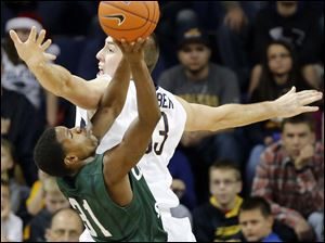 University of Toledo center Zach Garber (33) defends against Cleveland State Charlie Lee (31) during the first half.
