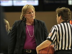 UT coach Tricia Cullop, left, listens to an official's explanation on a call.