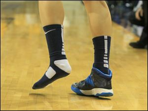 The Rockets' Ana Capotosto lost one sneaker during play in the first half.