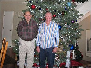 Elden Smith and John Nagel in front of their 17 foot tree.