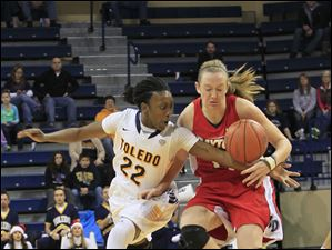 Toledo's Andola Dortch is called for a foul attempting to steal the ball from Dayton's Ally Malott.
