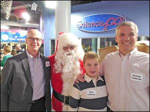 Don Rettig, Santa, Sam Lathrop and Father George Lathrop (George remembers coming to pass out goodies with his dad, making Sam the third Lathrop generation to help with the party).