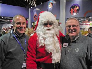 Executive Director Dave Wehrmeister, Santa and Board President Dan Frick
