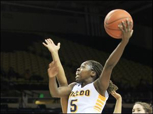 Toledo's Janelle Reed-Lewis drives to the basket.