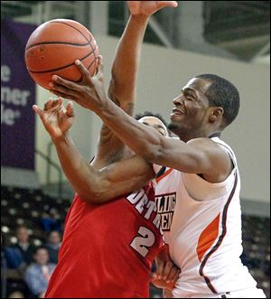 Spencer Parker gets off a shot despite the tight defense from Detroit's Juwan Howard, Jr.