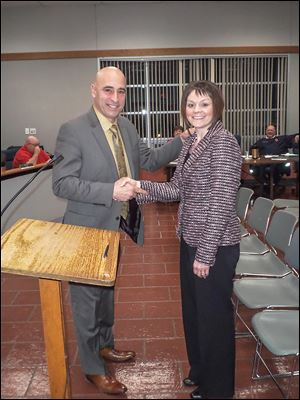 Melissa Purpura of Perrysburg Township shakes hands with Oregon Mayor Mike Seferian. She replaces Paul Goldberg.