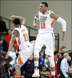BGSU's Damarkeo Lyshe, left, and Richaun Holmes celebrate their close win over Detroit at the Stroh Center.