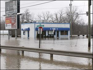 The flood water takes over a restaurant near the corner of E. High St. and S. Blanchard St.