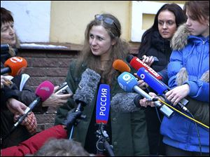 Maria Alekhina, second from left, a member of the Russian punk band Pussy Riot peaks to the media at the Committee against Torture after being released from prison, in Nizhny Novgorod, today.