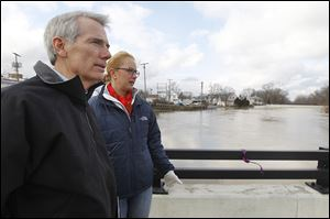 U.S. Sen. Rob Portman and Findlay Mayor Lydia Mihalik survey the flood scene. The mayor said Monday the river crested early that morning.
