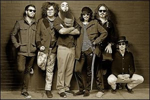 Members of Foxy Shazam, from left, Aaron McVeigh, Daisy Caplan, Sky White, Eric Nally, Loren Daniel Turner, and Alex Nauth.