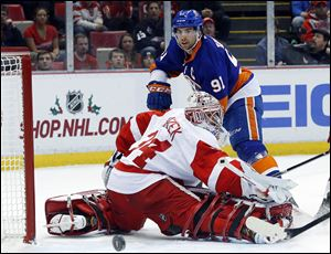 New York Islanders center John Tavares (91) shoots on Detroit Red Wings goalie Petr Mrazek (34), of the Czech Republic, in the first period.