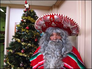 Julian Perez stands in his Pancho Claus suit in Lubbock, Texas. The retired 71-year-old has donned the Pancho Claus suit for 30 years to hand out gifts for low-income and at-risk children.
