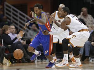 Cleveland Cavaliers' Kyrie Irving, right, fouls Detroit Pistons' Brandon Jennings (7) during the first quarter.