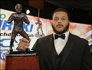 Pittsburgh's Aaron Donald poses with the Bronko Nagurski Trophy for the college football defensive player of the year.