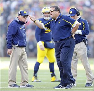 University of Michigan head coach Brady Hoke yells to his players during the fourth quarter of their football game against Ohio State University last month.