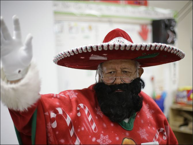 Pancho Claus Pancho Claus, Rudy Martinez, waves to children as he visits Knowlton Elementary School, in San Antonio Friday. Pancho Claus, a Tex-Mex Santa borne from the Chicano civil rights movement in the late 1970s and early 1980s, is now an adored Christmas fixture in many Texas cities.