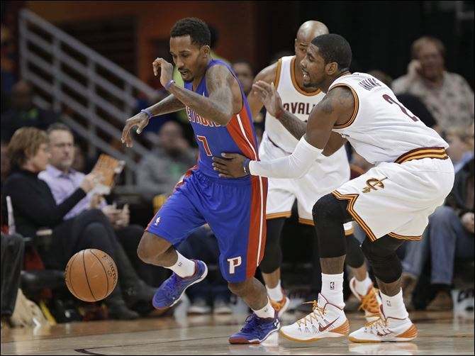 Pistons Cavaliers Basketball Cleveland Cavaliers' Kyrie Irving, right, fouls Detroit Pistons' Brandon Jennings (7) during the first quarter.