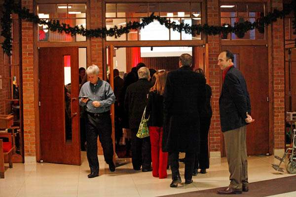 Church-goers-listen-to-carolers-as-they-wait-in-line