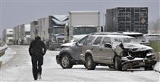 A-long-line-of-trucks-waits-for-hours-as-the-debris-from-the-I90-pile-up-is-cleared