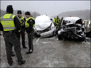 Safety forces work the scene of the pile-up.
