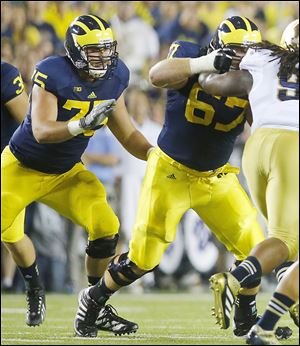 Michigan's Michael Schofield, left, has turned into one of the leaders for the Wolverines.
