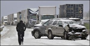 A long line of trucks waits for hours as the debris from the I90 pile-up is cleared.