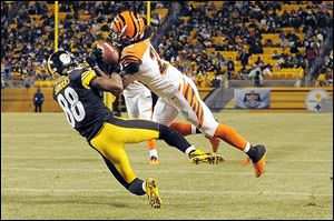 Cincinnati cornerback Adam Jones intercepts a pass intended for Pittsburgh's Emmanuel Sanders.