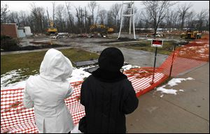 Carol Schortgen, left, and her mother, Rita Wannemacher, survey the site where St. Barbara Catholic Church once stood in Cloverdale, Ohio.