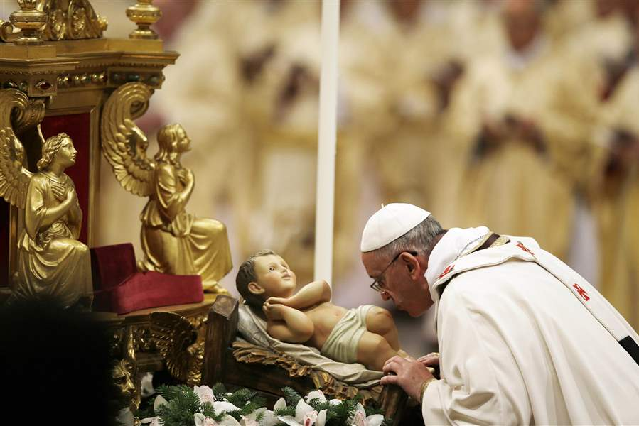 Francis Cradles A Baby Jesus Statue At Start Of His First