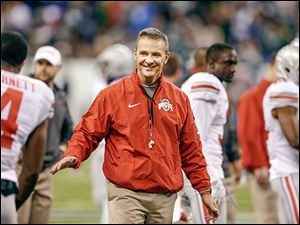 Ohio State coach Urban Meyer reportedly said he had no interest in the Texas job. Yet, outside in