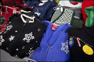 Selections of holiday wear for sale at Alley Vintage & Costume shop, in Columbus.