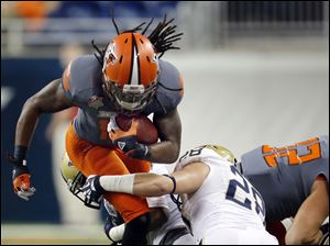 Bowling Green State University RB Travis Greene (13) runs the ball against Pitt LB Anthony Gonzalez (28).