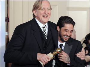 T Bone Burnett, left, who collaborated with Justin Timberlake on the  comic tune 'Please Mr. Kennedy,' won a Golden Globe Award in 2010 with Ryan Bing-ham for 'Crazy Heart.'