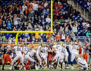 University of Pittsburgh kicker Chris Blewitt (12) kicks the game-winning field goal against Bowling Green State University during the Little Caesars Pizza Bowl on Thursday at Ford Field. The Falcons finish the season 10-4 and 0-1 for interim head coach Adam Scheier.