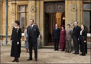 Elizabeth McGovern, left, as Lady Grantham, Hugh Bonneville as Lord Grantham, Dan Stevens as Matthew Crawley, Penelope Wilton as Isobel Crawley, Allen Leech as Tom Branson, Jim Carter as Mr. Carson, and Phyllis Logan as Mrs. Hughes appear in a scene in 'Downton Abbey.'