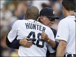 Torii Hunter hugs Tigers manager Jim Leyland after hitting a game-winning single. Leyland, 69, retired after 22 seasons as a manager, the final eight with Detroit.