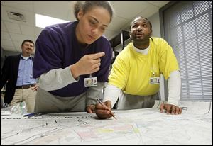 Gang members 'Kidd,' left, and 'King Chaos,' who were incarcerated at the Lucas County Correctional Treatment Facility, worked on identifying gang territories for a gang map that The Blade assembled.