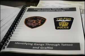 The Lucas County jail gang identifying folder is used by officials to distinguish gang markings.