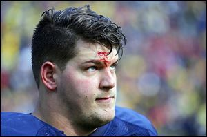 Offesive lineman Taylor Lewan will play his final game with the University of Michigan today, just a few miles from where he improved his grades enough in high school to go to college.