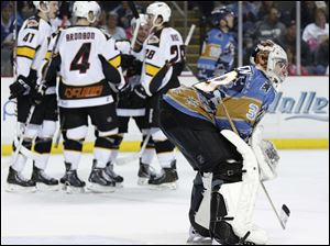 Walleye goalie Hannu Toivonen looks on as Cincinnati celebrates yet another goal during the 2nd period.
