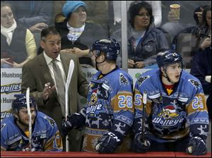 Walleye hockey head coach Nick Vitucci talks to Pat Mullane during the game.