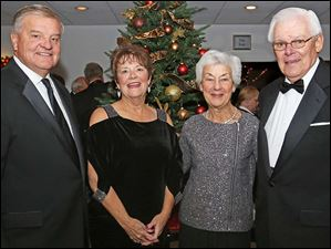 President John Bachey, left, his wife Elane, center left, Laurie Seibold, center right, and Past President Bill Seibold, right, attended the Winter Ball at Belmont Country Club in Perrysburg.